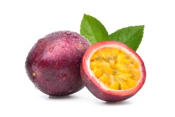 Purple passion fruit (Passiflora edulis) with cut in half and green leaf isolated on white background.