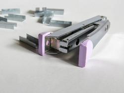 Purple plastic on a stapler.