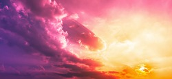 Purple red clouds with orange sun light in pink sky