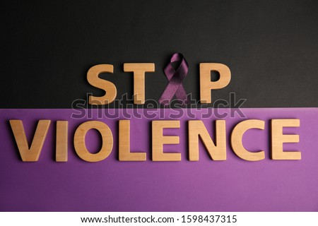 Purple ribbon and phrase STOP VIOLENCE on color background, flat lay