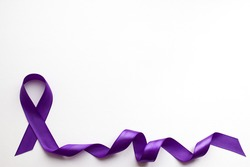 Purple ribbon on white background with place for text in honor of the day of patients with epilepsy on March 26