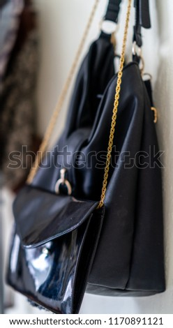 Purple School Backpack Hanging on the Wall - Isolated Object with White Background