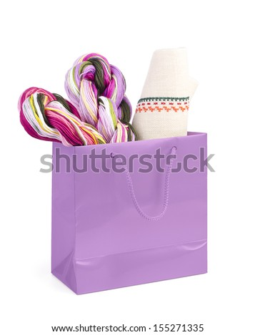 purple  shopping bag with gift on white background