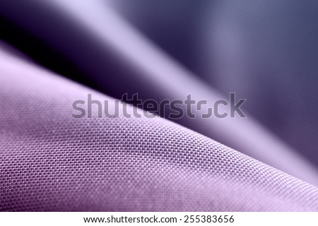 Purple silk. Textile industry and fabric backgrounds.
