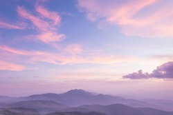 Purple sky, misty mountains and clouds