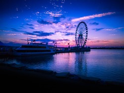 Purple sunset by the harbor. National Harbor is located along the Potomac River, south of Washington, D.C. and near the Woodrow Wilson Bridge. It was originated as a multi use waterfront development.