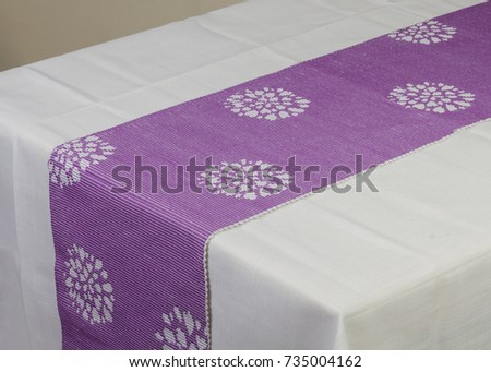 Purple table runner on white table cloth #735004162