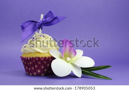 Purple theme cupcake with orchid flower for wedding, bridal or baby shower, mothers day, or female birthday.
