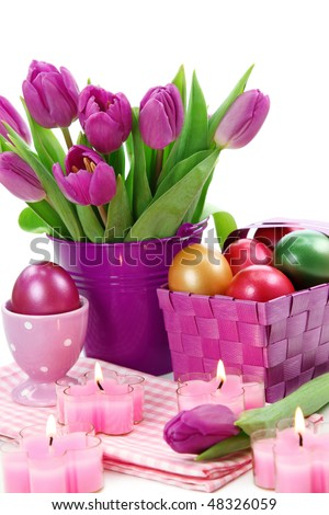 Purple tulips in bucket and easter eggs isolated on white background