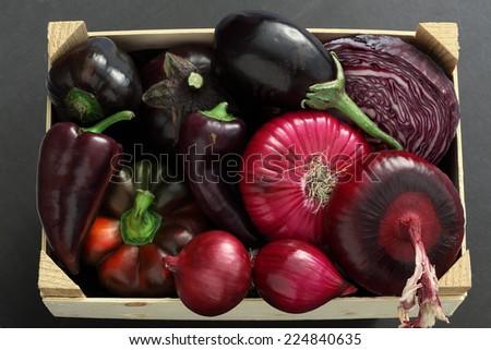 Purple vegetables box:  eggplant, red onion, red cabbage head, radicchio, purple bell pepper, basil