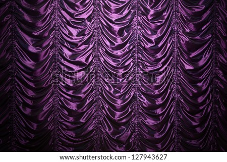 Purple waved silk curtain background with copy space