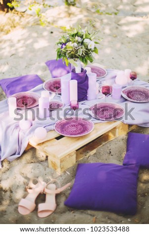 Purple Wedding Table Decoration With Plates Glasses Candles