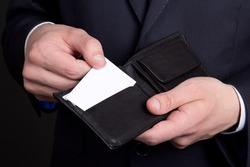 purse with blank visiting card in business man hand