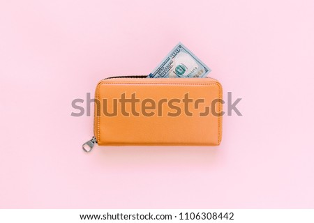Purse with hundred dollar banknotes on pink background. Flat lay, top view, copy space  Сток-фото ©