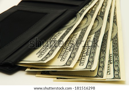 Purse with money on white background