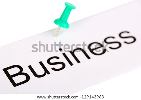 Push pin on paper with word business written on it isolated on white
