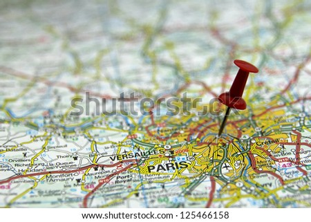 push pin pointing at Paris, France