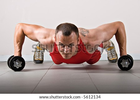 Push up with dumbbells, classic endurance exercise for biceps