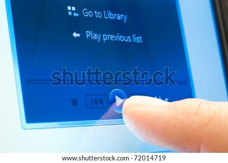 pushing play button on touch screen device