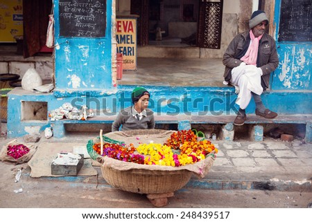 PUSHKAR, INDIA - JAN 08: Indian child selling flowers on street of Pushkar on January 08, 2015. Agra is a town in the Ajmer district in the Indian state of Rajasthan.