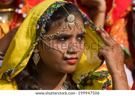 PUSHKAR, INDIA - NOVEMBER 21, 2012 : An unidentified girl attends the Pushkar fair, Rajasthan, India. Pilgrims and camel traders flock to the holy town for the annual fair.