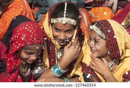PUSHKAR INDIA NOVEMBER 21 An unidentified group of girls in colorful ethnic attire attends at the Pushkar fair on November 21 2012 in Pushkar Rajasthan India