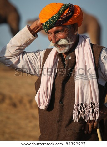 PUSHKAR, INDIA - NOVEMBER 19: An unidentified man attends the Pushkar fair on November 19, 2010 in Pushkar, Rajasthan, India. Pilgrims and camel traders flock to the holy town for the annual fair.