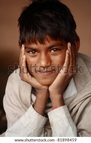 PUSHKAR, INDIA - NOVEMBER 18: An unidentified Rajasthani rural boy poses for camera at Pushkar Fair on November 18, 2010. Pushkar fair is held annually in Rajasthan to trade camels, horses and cattle