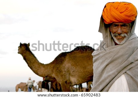 PUSHKAR, INDIA - NOVEMBER 18: Camel trader at the Pushkar Camel Fair on November 18, 2010.  The fair is held annually in Pushkar, Rajasthan to buy and sell camels for commercial purposes.