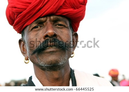 PUSHKAR, INDIA - NOVEMBER 18: Camel traders at the Pushkar Camel Fair on November 18, 2010. The fair is held annually in Pushkar, Rajasthan to buy and sell camels for commercial purposes. - stock photo