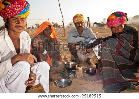 PUSHKAR, INDIA - NOVEMBER 7: Camel traders attend the Pushkar Cattle Fair on November 7, 2011 in Pushkar, Rajasthan, India. Pilgrims and camel traders flock to the holy town for the annual fair.