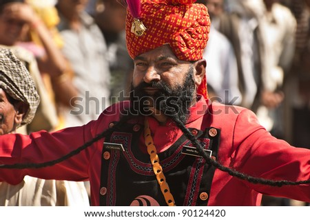 PUSHKAR, INDIA - NOVEMBER 7: Participant J.S.Chouhan shows his moustache at moustache competition at Pushkar cattle fair on November 7, 2011 in Pushkar, Rajasthan, India. He was declared runner up.