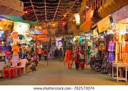 Pushkar, India - November 02, 2017: People walking at a busy market street at night. #782573074