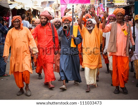 PUSHKAR, INDIA - NOVEMBER 19: Unidentified holy men attends the Pushkar fair on November 19, 2010 in Pushkar, Rajasthan, India. Pilgrims and camel traders flock to the holy town for the annual fair.