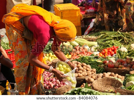 PUSHKAR, INDIA - NOVEMBER 19:Unidentified woman sells vegetables at fair on November 19, 2010 in Pushkar, Rajasthan, India. Pilgrims and camel traders flock to the holy town for the annual fair.
