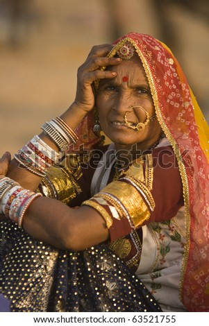 PUSHKAR, INDIA - NOVEMBER 9: Unknown indian lady in traditional tribal dress on November 9, 2008 at the annual camel fair in Pushkar, Rajasthan, India.