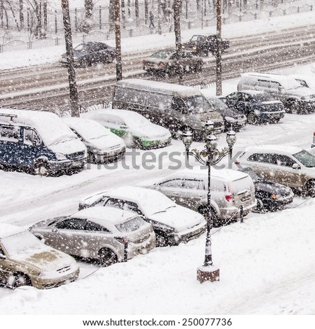 Pushkino, Russia, on February 2, 2015. A view of a parking in the inhabited massif in blizzard time