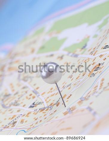 Pushpin and map
