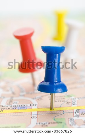 Pushpins marking a location on a road map