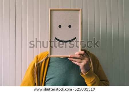 Put a happy optimistic face on, happiness and cheerful emotions concept, man holding picture frame with smiley emoticon printed.