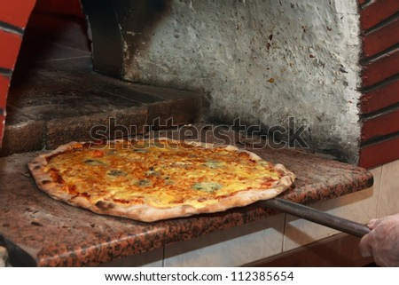 Put a pizza in the oven
