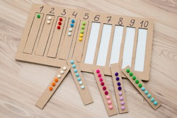 put correct strap with balls of cotton wool to assigned cavity with number.  preschool educational aid for kindergartens. children early learning montessori kit for intelligence