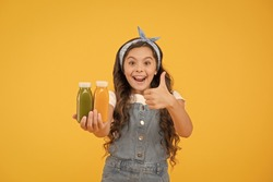 Put like. Happy little child gesture thumbs up for food product. Promoting product. Promoting healthy eating habits at young age. Promoting healthy nutrition. Promoting and advertising.