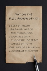 Put on the full armor of God written on old paper with fountain pen.