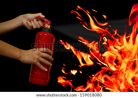 put out the fire with fire extinguisher Stockfoto ©