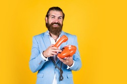 put the phone down. nice conversation. bearded man in formalwear speak on retro phone. elegant businessman has business talk. communication. true gentleman with groomed hair hold vintage telephone