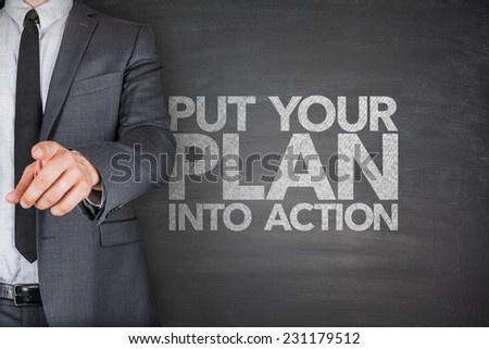 Put your plan into action on blackboard with pile of dollars