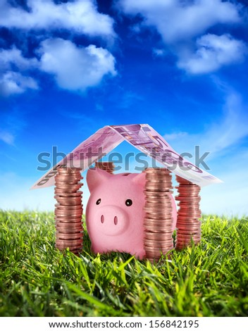put your savings safe - Piggybank in the home of Savings under the serenity sky - stock photo