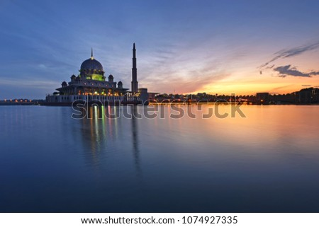 Putra Mosque in Putrajaya Malaysia. Beautiful reflections during sunrise.   #1074927335