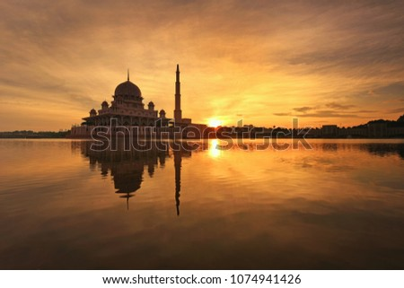 Putra Mosque in Putrajaya Malaysia. Beautiful reflections during sunrise.   #1074941426